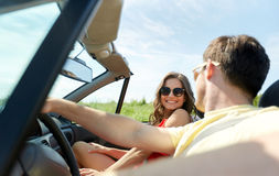 Happy couple driving in cabriolet car at country Royalty Free Stock Images