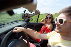 Happy couple driving in cabriolet car at country Royalty Free Stock Photo