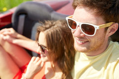 Happy couple driving in cabriolet car and hugging Royalty Free Stock Photo