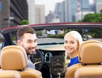 Happy couple driving in cabriolet car over city Royalty Free Stock Photography