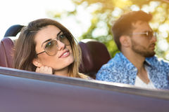 Happy Couple Driving in Convertible car over sunset royalty free stock photography