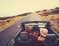 Happy Couple Driving in Convertible Stock Photo