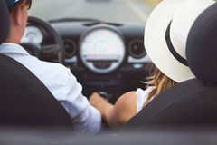 Happy Couple Driving on Country Road  in Car Royalty Free Stock Images
