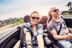 Happy couple in the car royalty free stock photos