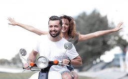 Happy couple driving scooter excited on summer holidays vacation royalty free stock photos