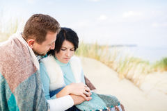 Happy couple in a dune Royalty Free Stock Image