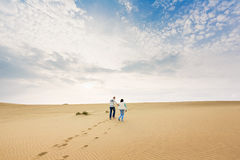 Happy couple in a dune Stock Photography