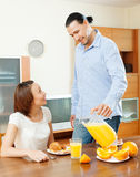 Happy couple eating breakfast Stock Photos