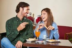 Happy couple eating breakfast Stock Photography