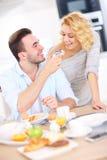 Happy couple eating breakfast Stock Image