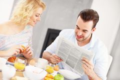 Happy couple eating breakfast Royalty Free Stock Images