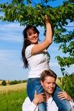 Happy couple eating cherries in summer Royalty Free Stock Photo