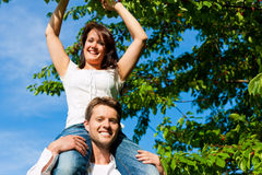 Happy couple eating cherries in summer Royalty Free Stock Images