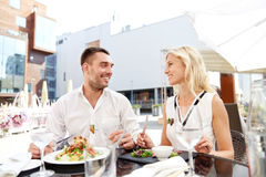Happy couple eating dinner at restaurant terrace Stock Photography