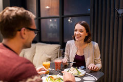 Happy couple eating dinner at vegan restaurant Royalty Free Stock Photography