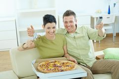 Happy couple eating pizza Stock Images