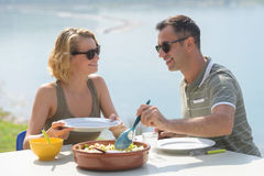Happy couple eating salad for dinner at restaurant terrace. Happy couple eating salad for dinner at a restaurant terrace Royalty Free Stock Photo
