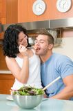 Happy couple eating salad together Royalty Free Stock Image