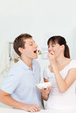 Happy couple eating together Stock Photo
