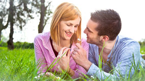 Happy couple ejoying outdoor in park. Royalty Free Stock Photo