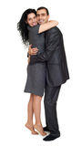 Happy couple embrace, dressed in strong classic dress, studio portrait on white Stock Image