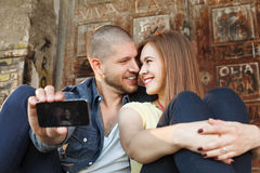 Happy couple in embrace takes selfie Royalty Free Stock Photography