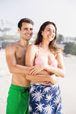 Happy couple embracing on beach Stock Images