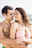 Happy couple embracing on beach Royalty Free Stock Photo