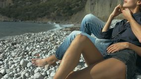 Happy couple embracing on the beach. Happy couple smiling and embracing on the beach stock video footage