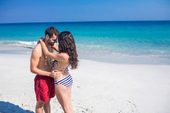 Happy couple embracing at the beach Stock Photos