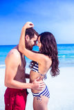 Happy couple embracing at the beach Stock Images