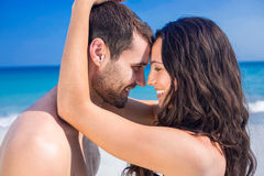 Happy couple embracing at the beach Royalty Free Stock Photography