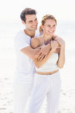 Happy couple embracing on the beach Royalty Free Stock Photo