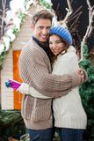 Happy Couple Embracing At Christmas Store Stock Image