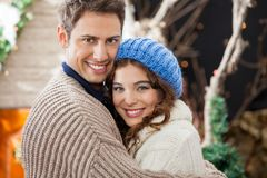 Happy Couple Embracing In Christmas Store Royalty Free Stock Photos