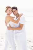 Happy couple embracing each other on the beach Royalty Free Stock Images