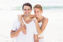 Happy couple embracing each other on the beach Stock Photography