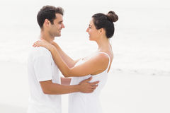 Happy couple embracing each other on the beach Royalty Free Stock Photography