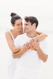 Happy couple embracing each other on the beach Royalty Free Stock Photos