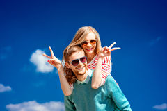 Happy couple embracing and having fun under the blue sky Stock Image
