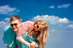 Happy couple embracing and having fun under the blue sky Royalty Free Stock Photos