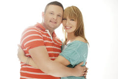 Happy Couple Embracing While Looking at Camera Royalty Free Stock Image