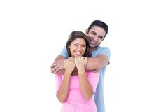 Happy couple embracing and looking at the camera Stock Images
