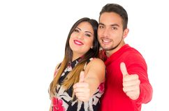 Happy couple embracing and looking camera, with thumbs up, on white background stock photos