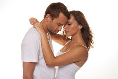 Happy couple embracing and looking stock photo