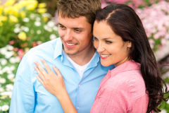 Happy couple embracing in nature garden Stock Photo
