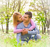 Happy couple embracing outdoor in park. Royalty Free Stock Photo