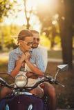 Happy couple embracing outdoors Stock Photo