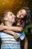Happy couple embracing in the park Stock Photo