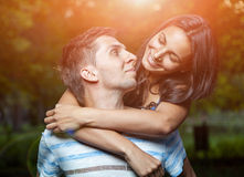 Happy couple embracing in the park Royalty Free Stock Photos